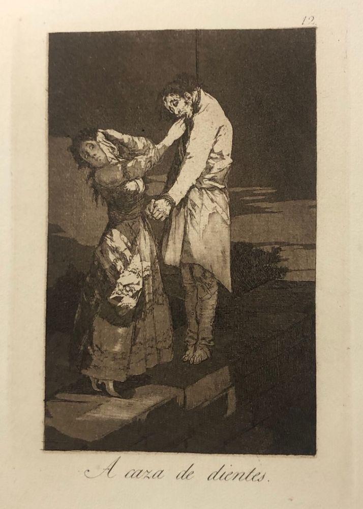Engraving Goya - Capricho 12 . A caza de los dientes